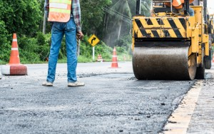 back-view-standing-engineer-small-asphalt-roller-duty-repairing-repairing-asphalt-road-workers-road-construction-industry-teamwork_157563-1-1