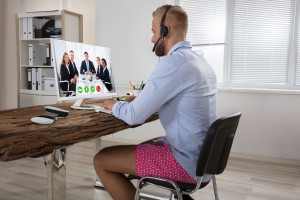 businessman-attending-video-conference-on-computer-5e95693b443af